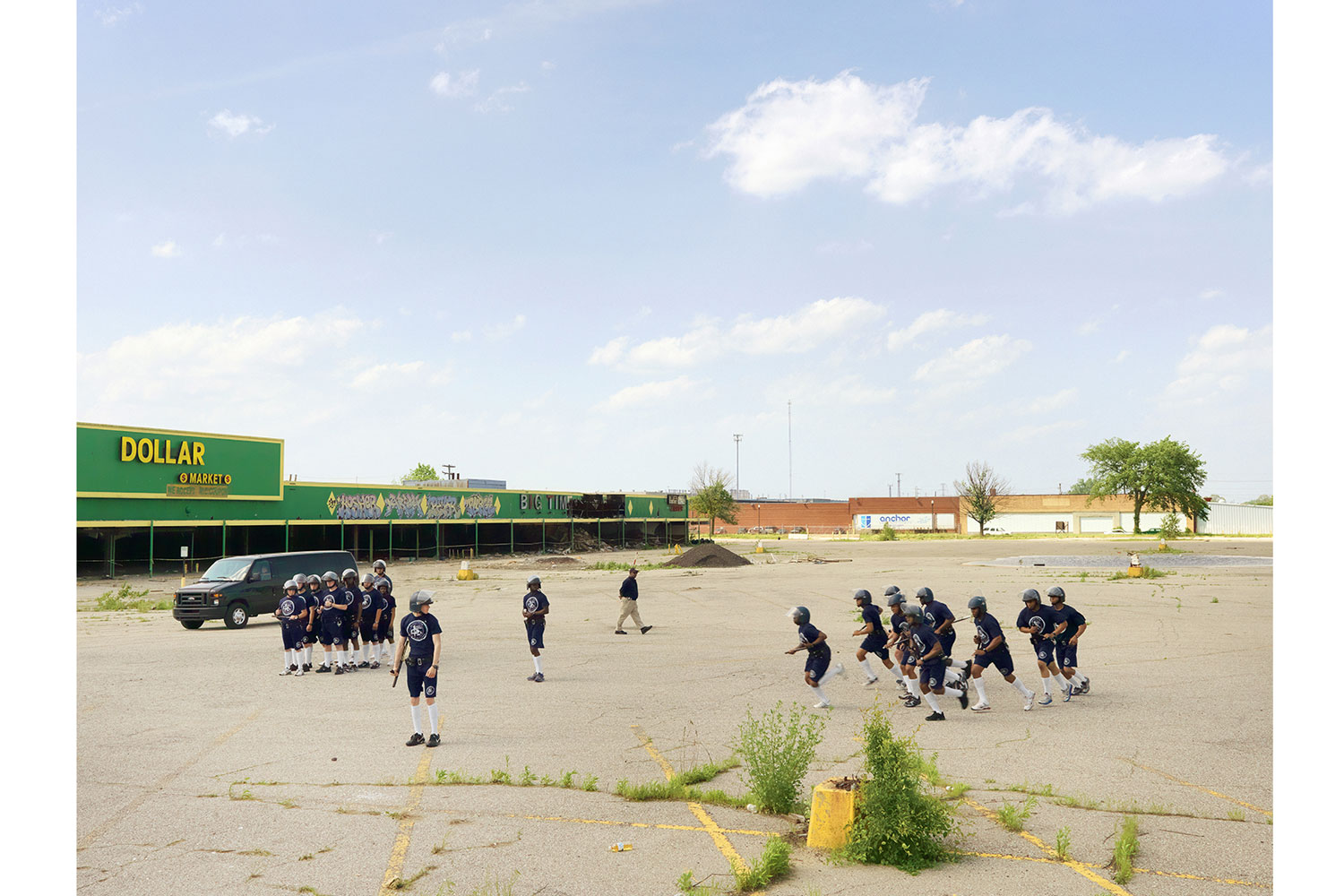 Police Cadet Riot Control Training, Northeast Side, Detroit, 2011                                                              The Detroit Police Academy will often train cadets in open public spaces in order to show local residents that their tax dollars are going to good use and to promote better public relations.