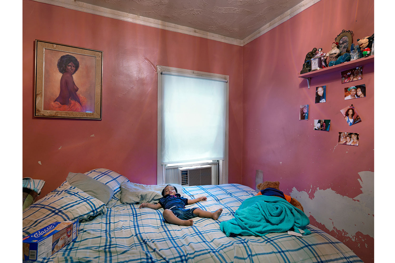 Semira Sleeping in Kat's House, Eastside, Detroit, 2012                                                              The child of a homeless mother sleeps in Kat's bedroom. Kat will take anyone into her home who needs food or shelter. Often as many as eight people stay in her small two-bedroom house.