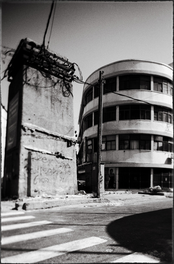 The Electric Transformer,  Jaffa Road, Tel Aviv, 2009. On January 11, 2010, the photographer publicly burned all the negatives to this series on the architecture of Tel Aviv in protest to the current day working conditions of professional photographers who often go uncompensated for their work.