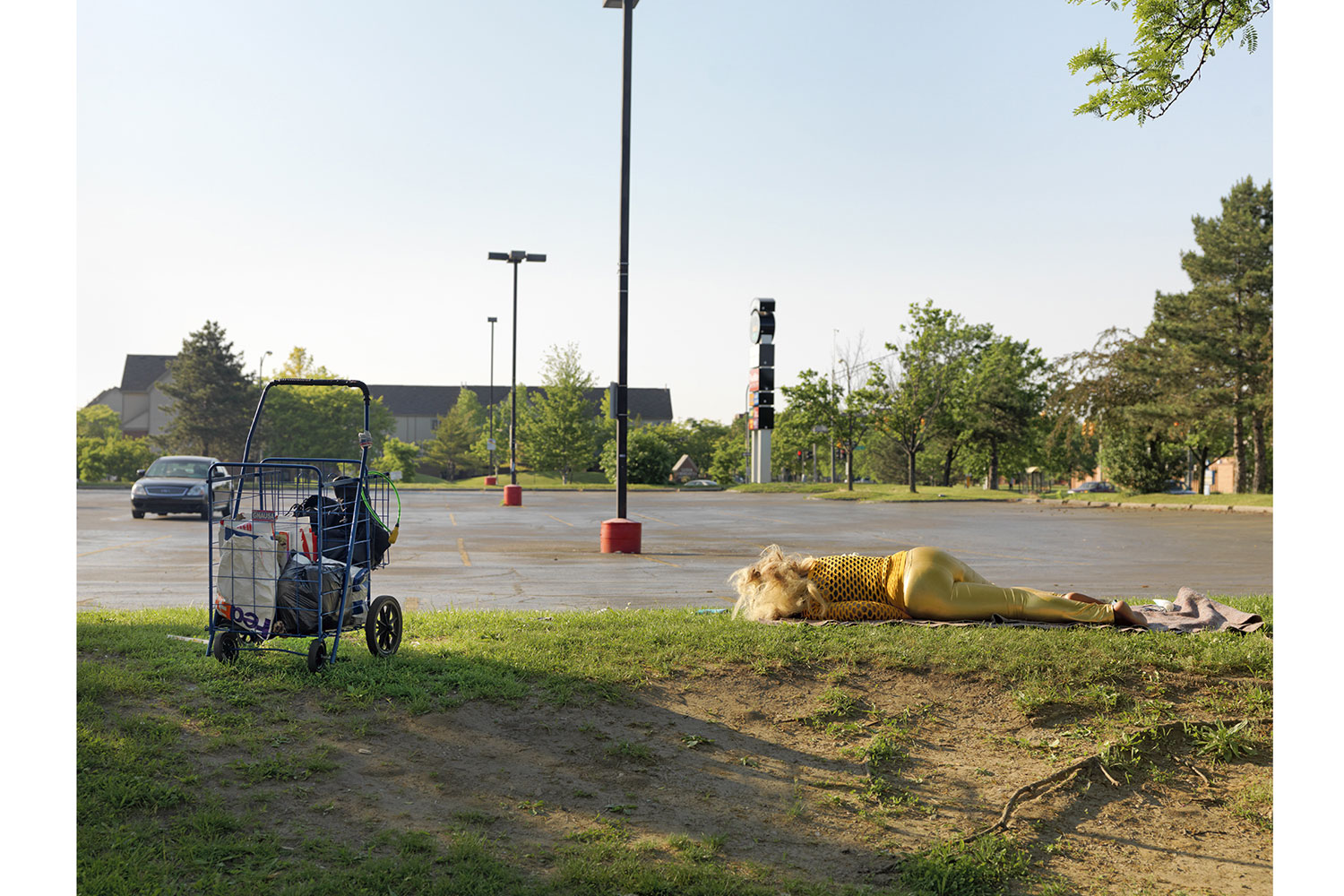 A Woman Sleeping in a Parking Lot Near East Warren Avenue, Detroit, 2010                                                              There are many homeless shelters in Detroit where victims can go in order to seek out help, but many can't or will not go for various reasons.  Often mental illness, a lack of trust or anti-social behavior prevents homeless people from reaching out.