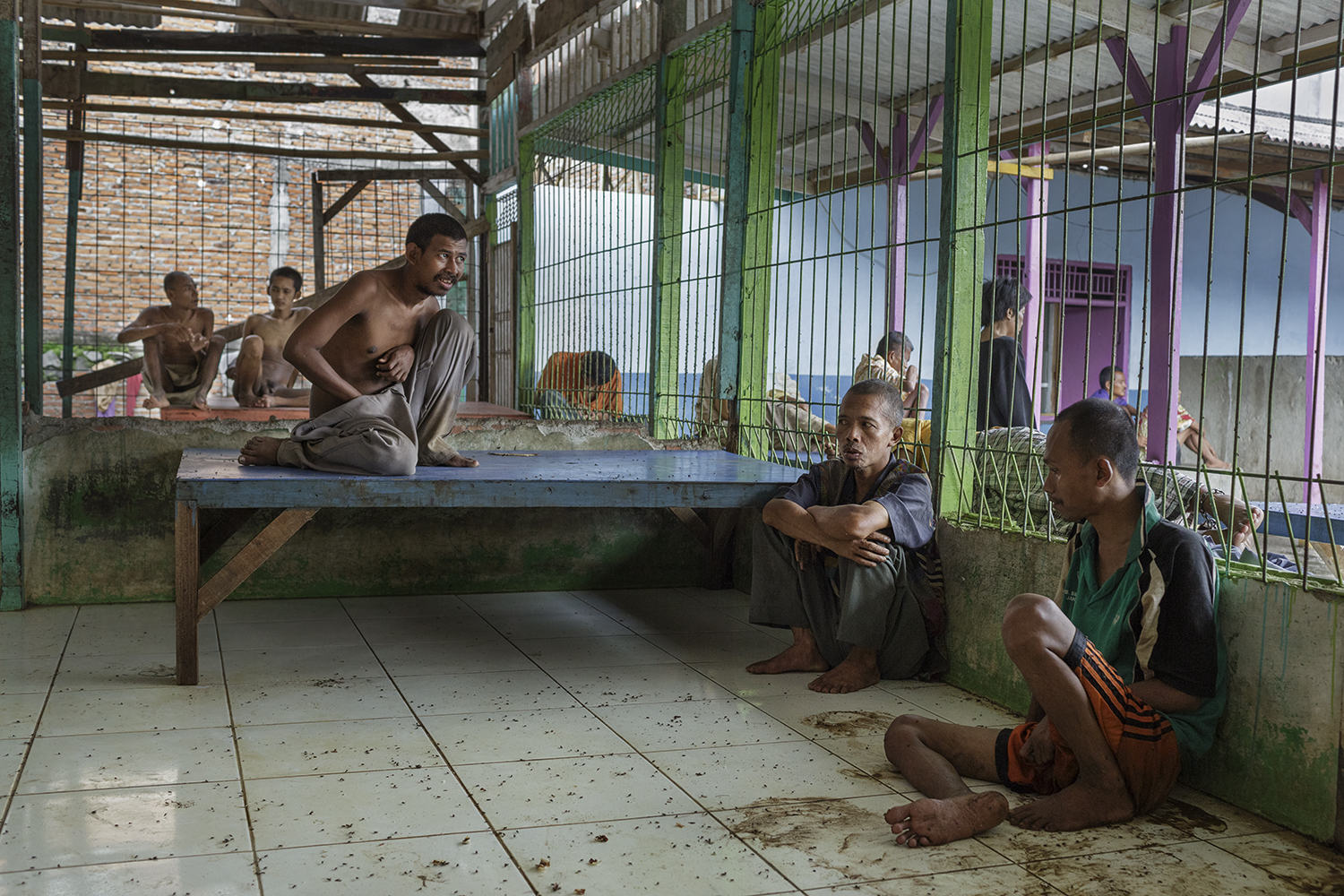 At Galuh, there is no actual housing although small rooms have been built for management and staff. Many of the men and woman stay in the large cage enclosed pavilion under a leaking roof without access to the outdoor toilets.