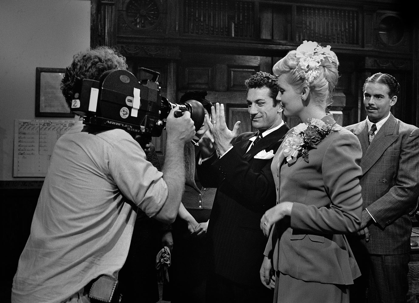 Mike Chapman, cinematographer, shoots a scene which would run in the movie as home footage — the only color segment in the black-and-white film.