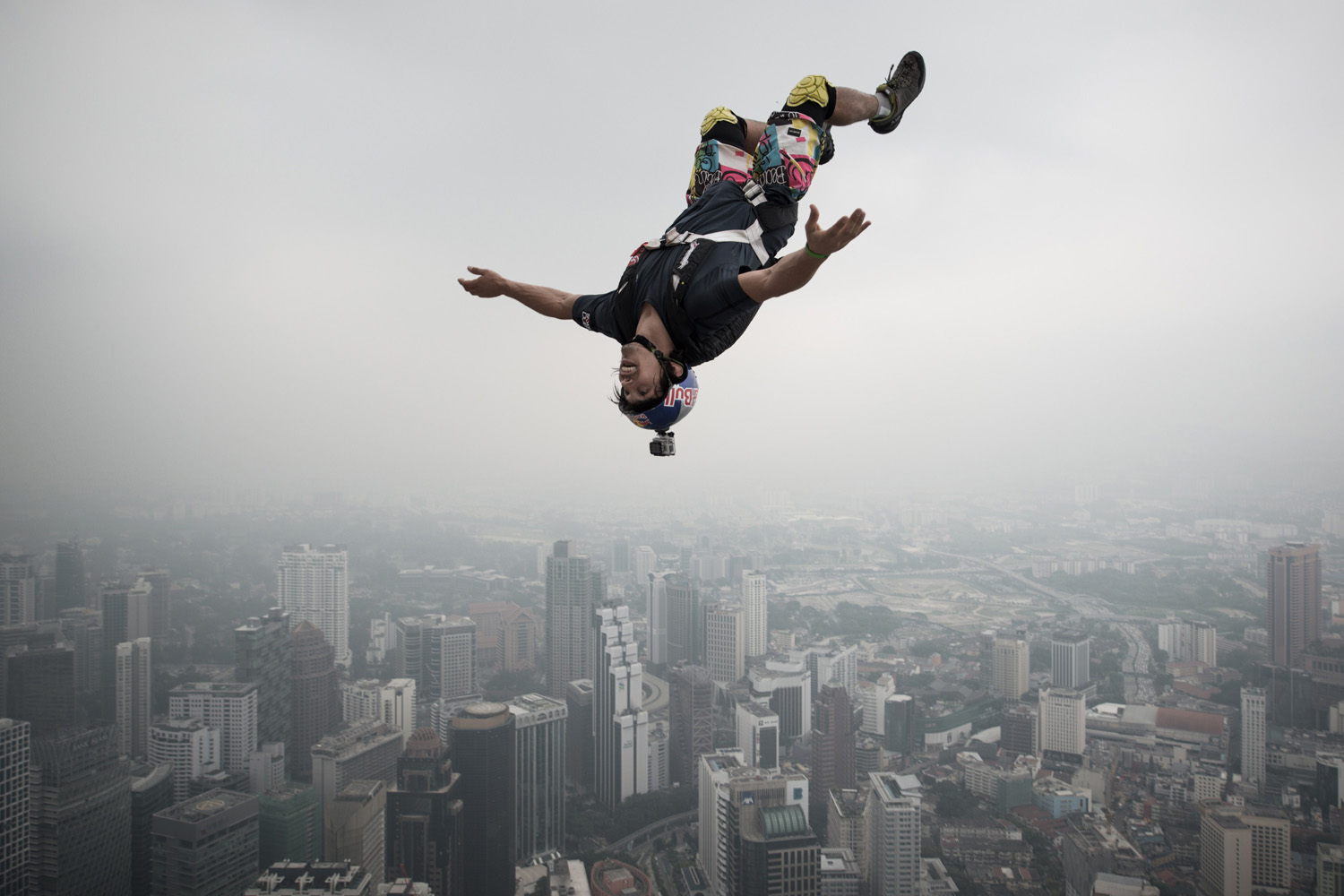 Base jumper Vincent Philippe Benjamin Reffet from France leaps from the 300-meter Open Deck of Malaysia's landmark Kuala Lumpur Tower during the International Tower Jump in Kuala Lumpur.