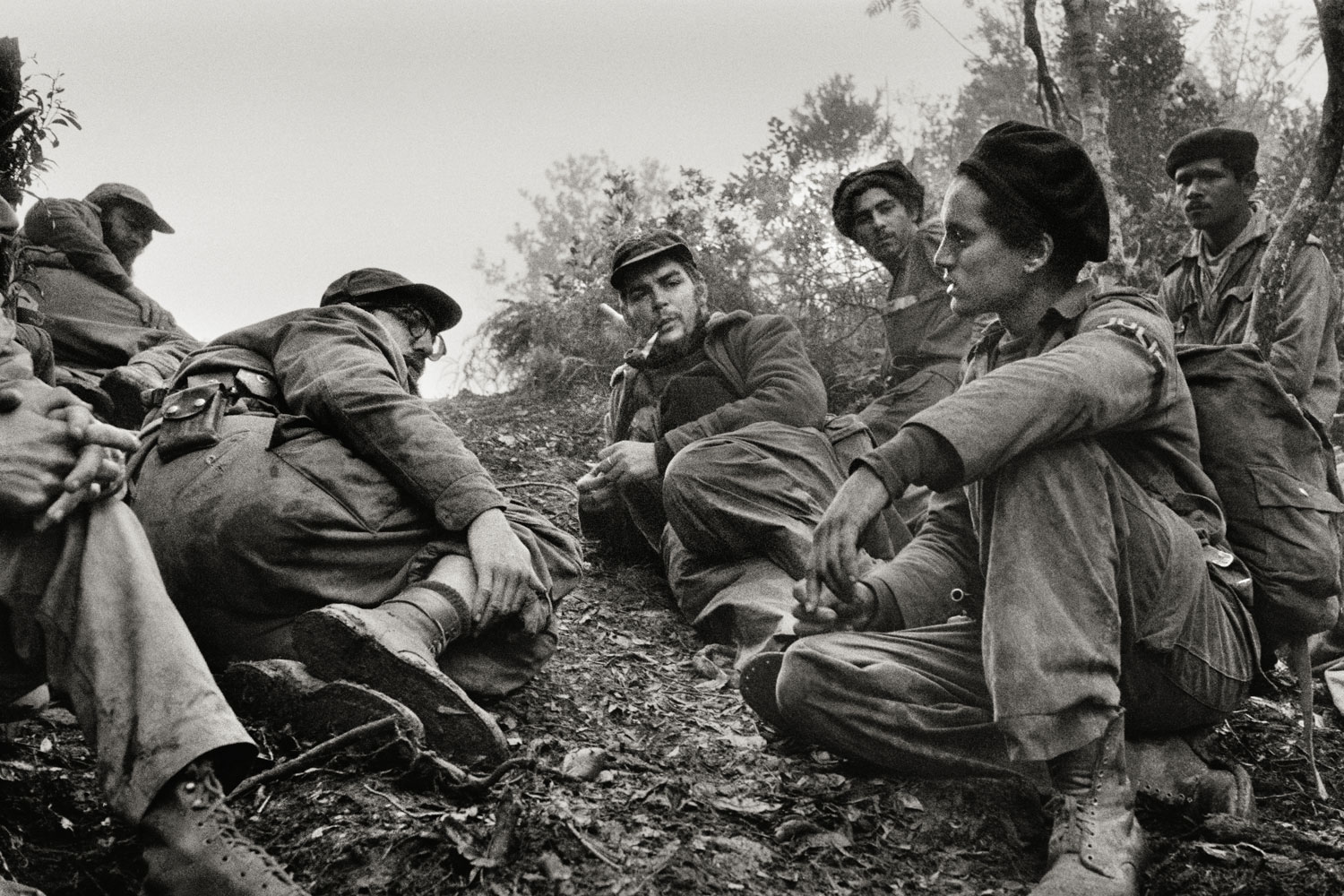 During the Battle of Pino del Agua, Fidel Castro and Che Guevara talk to a fellow rebel, who had just come from spying on Batista's troops, in the  Sierra Maestra mountains, Cuba, 1958.