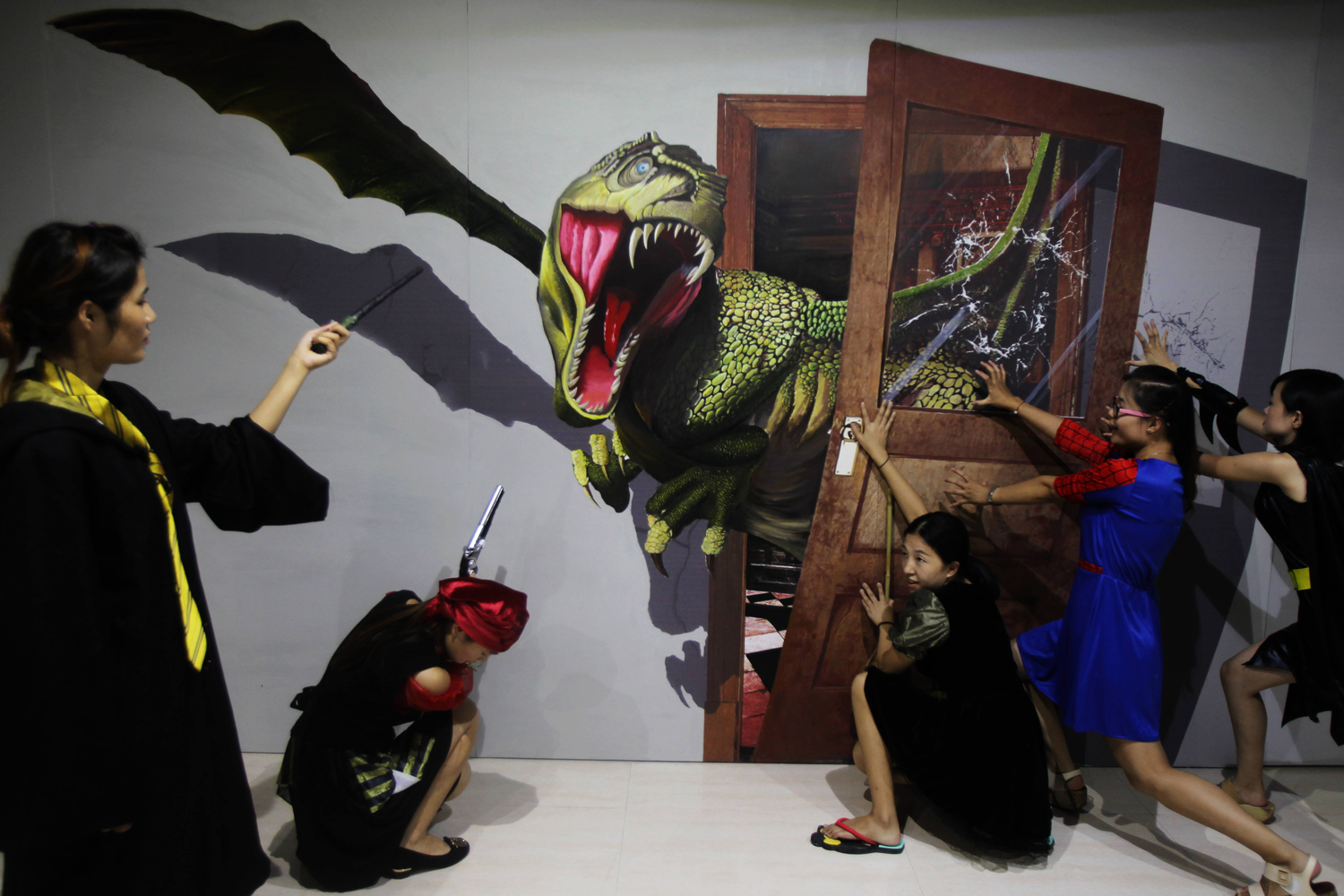 Assistants pose for photos at a 3D studio in Hai'an County of Nantong City, east China's Jiangsu Province.