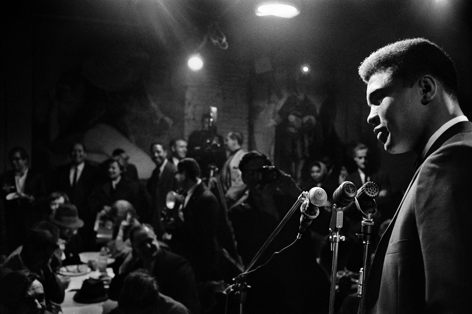 Muhammad Ali - then known as Cassius Clay - reading his poetry at Take Three, a bar in Lower Manhattan, New York, circa 1963.