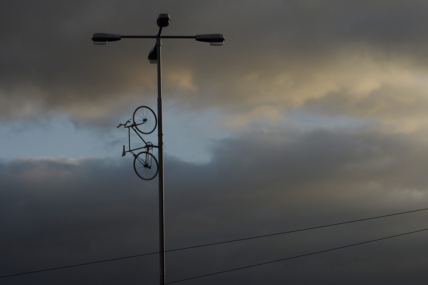Sept. 23, 2013. A view of a silver-covered bicycle mounted in a public city lamp post, called Bike to Heaven is seen in Prague, Czech Republic.