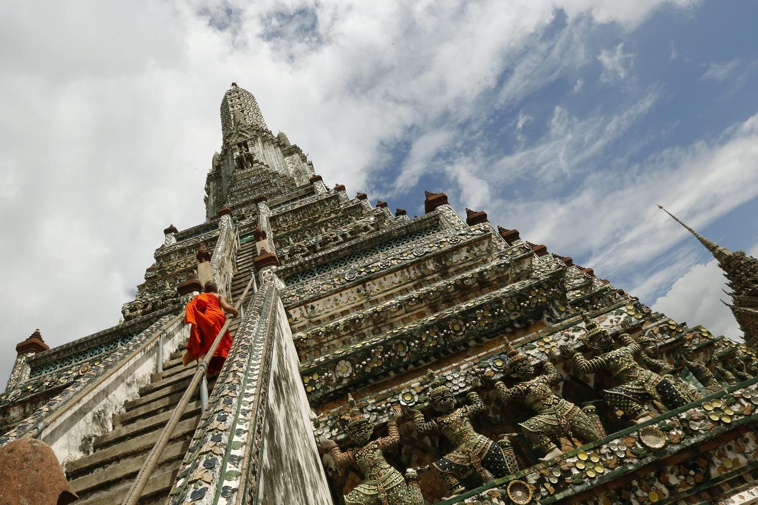 Sept. 24, 2013. A Thai Buddhist novice walks up to the top of the ancient pagoda at Wat Arun or the 'Temple of Dawn' in Bangkok, Thailand.