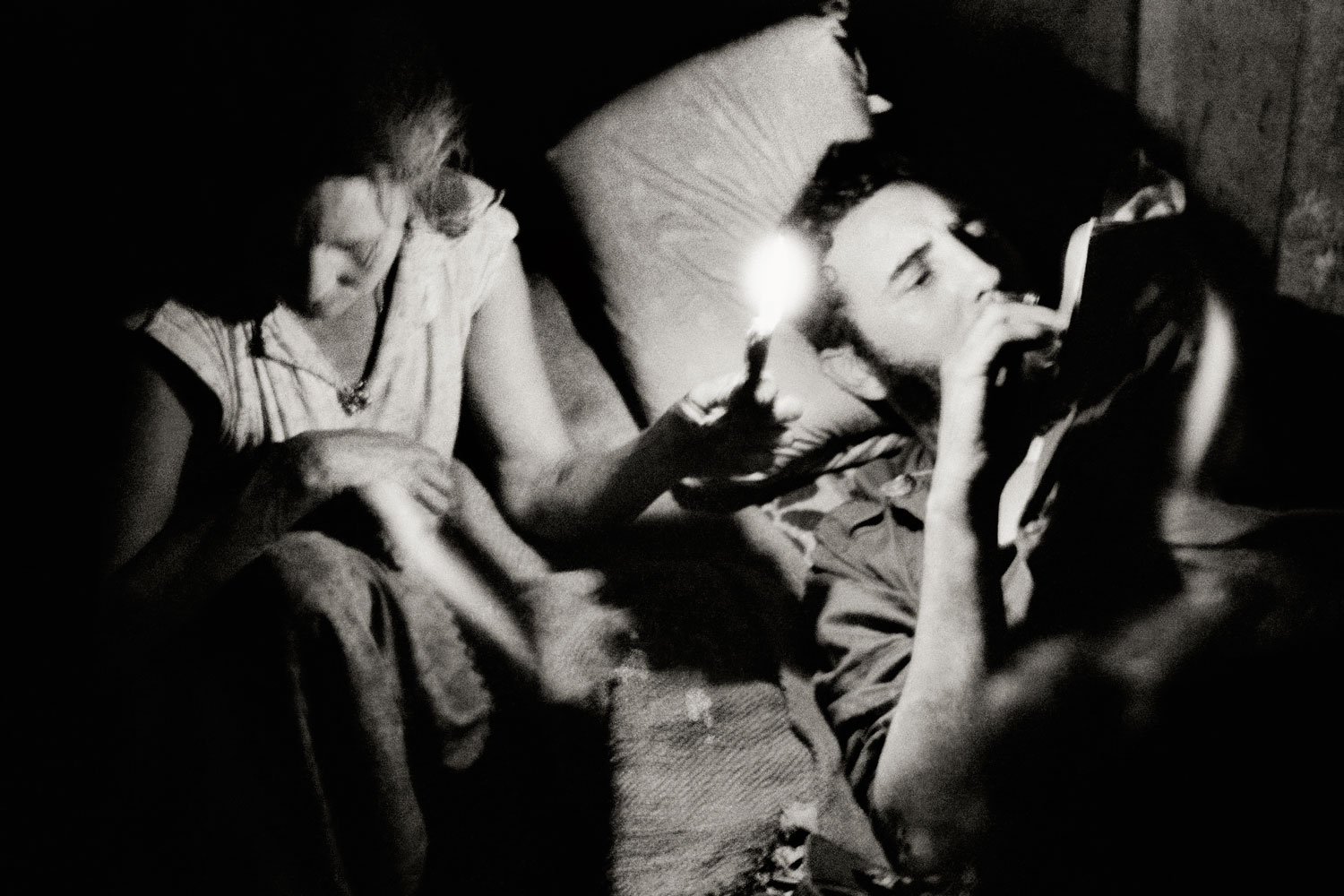 Fidel Castro reads at night during the Battle of Pino del Agua, in the Sierra Maestra mountains, Cuba, 1958.