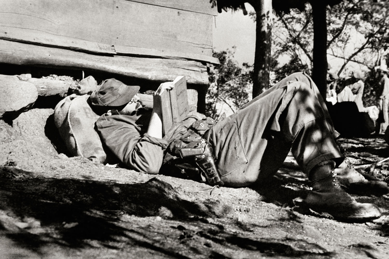 Fidel Castro reading Curzio Malaparte's  Kaputt,  in the Sierra Maestra mountains, Cuba, 1958.