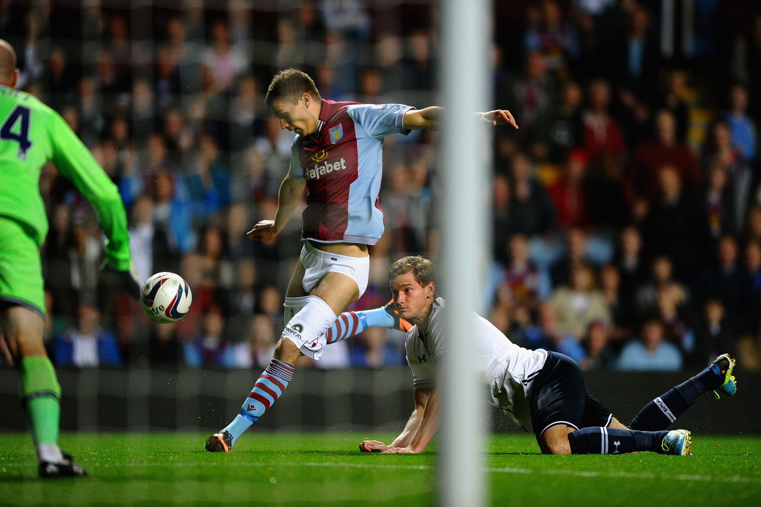 Sept. 24, 2013. Jan Verttonghen of Tottenham Hotspur hangs on to the shorts of Nicklas Helenius of Aston Villa during the Capital One Cup third round match between Aston Villa and Tottenham Hotspur at Villa Park in Birmingham, England.