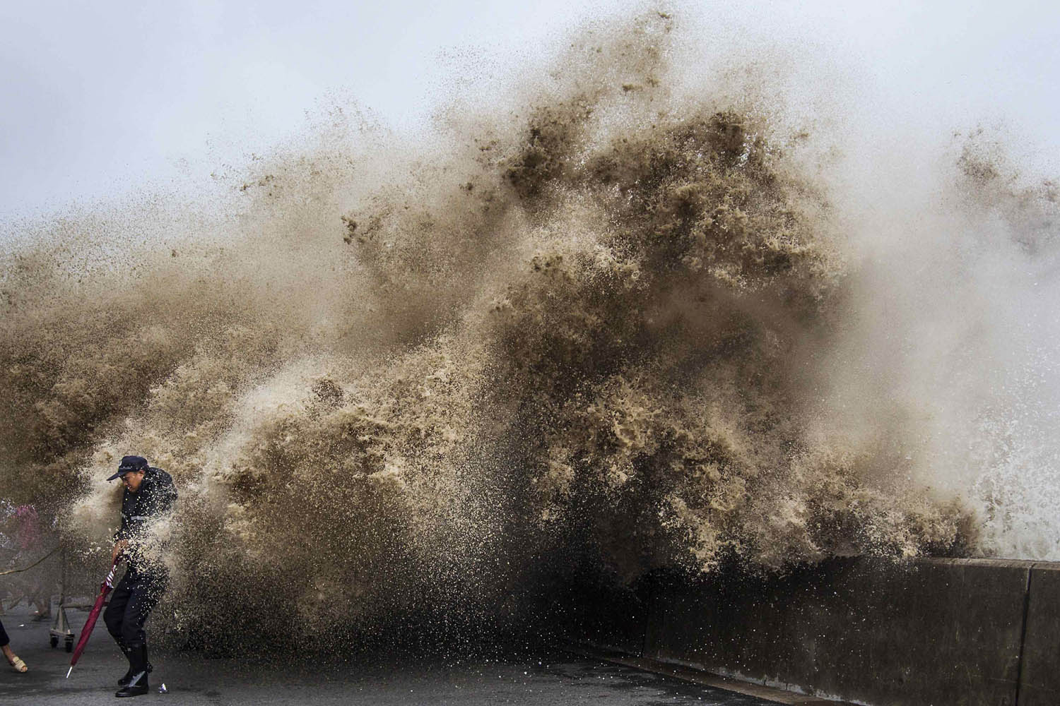 Sept. 21, 2013. A man dodges tidal waves under the influence of Typhoon Usagi in Hangzhou, Zhejiang province, China.