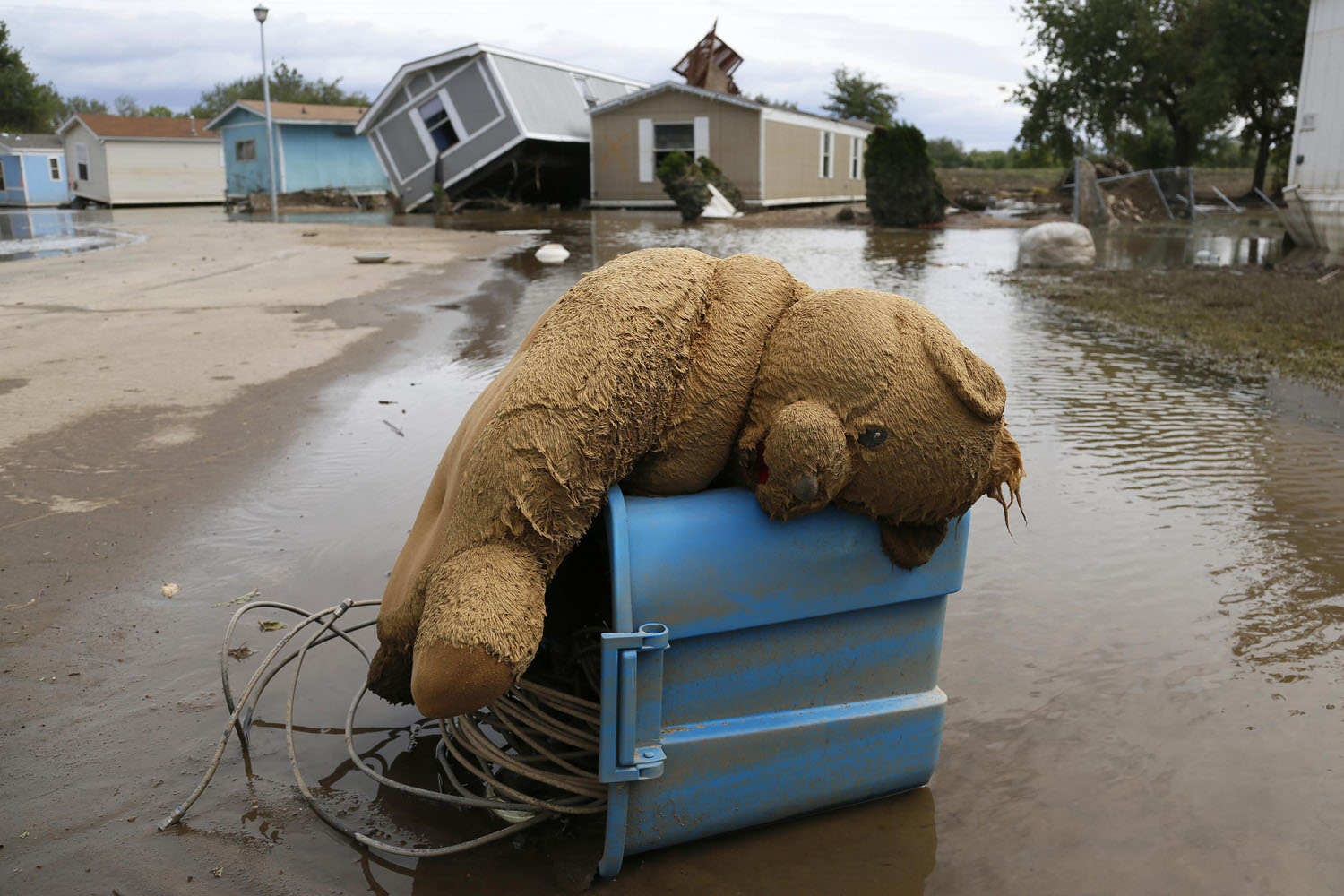 Sept. 23, 2013. A stuffed teddy bear chair lies slumped over in the flooded Eastwood Village in Evans, Colorado.