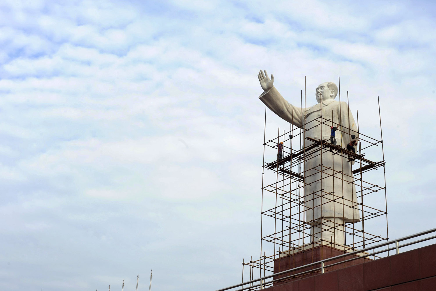 Sept. 24, 2013. Laborers set up scaffolding to clean a statue of China's late chairman Mao Zedong for the upcoming Chinese National Day at Tianfu Square in Chengdu, Sichuan province.