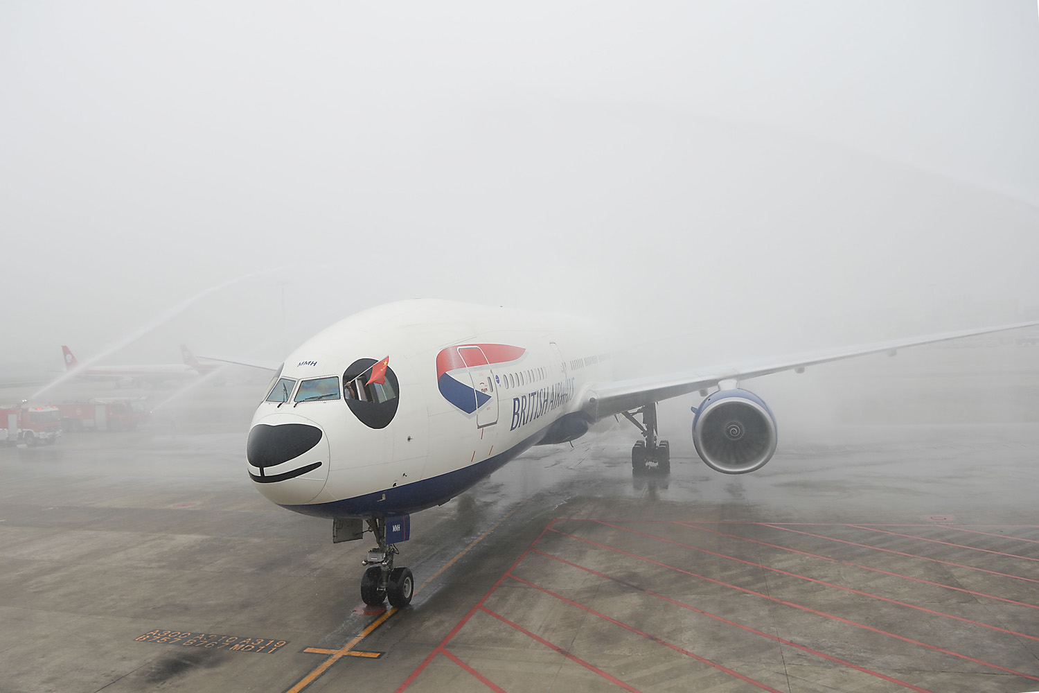 Sept. 23, 2013. Flight BA89 of British Airways is washed at the Shuangliu International Airport in Chengdu, capital of southwest China's Sichuan Province.