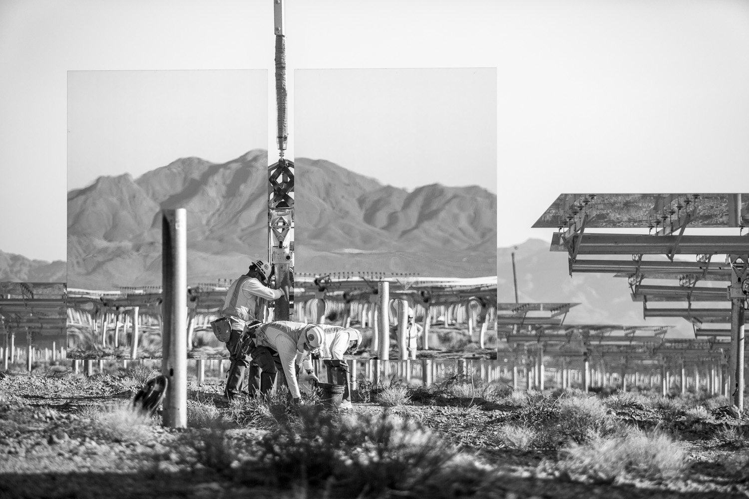 <i>Heliostat installation, June 2012</i>Workers installing a heliostat (pair of mirrors) at Solar Field One.