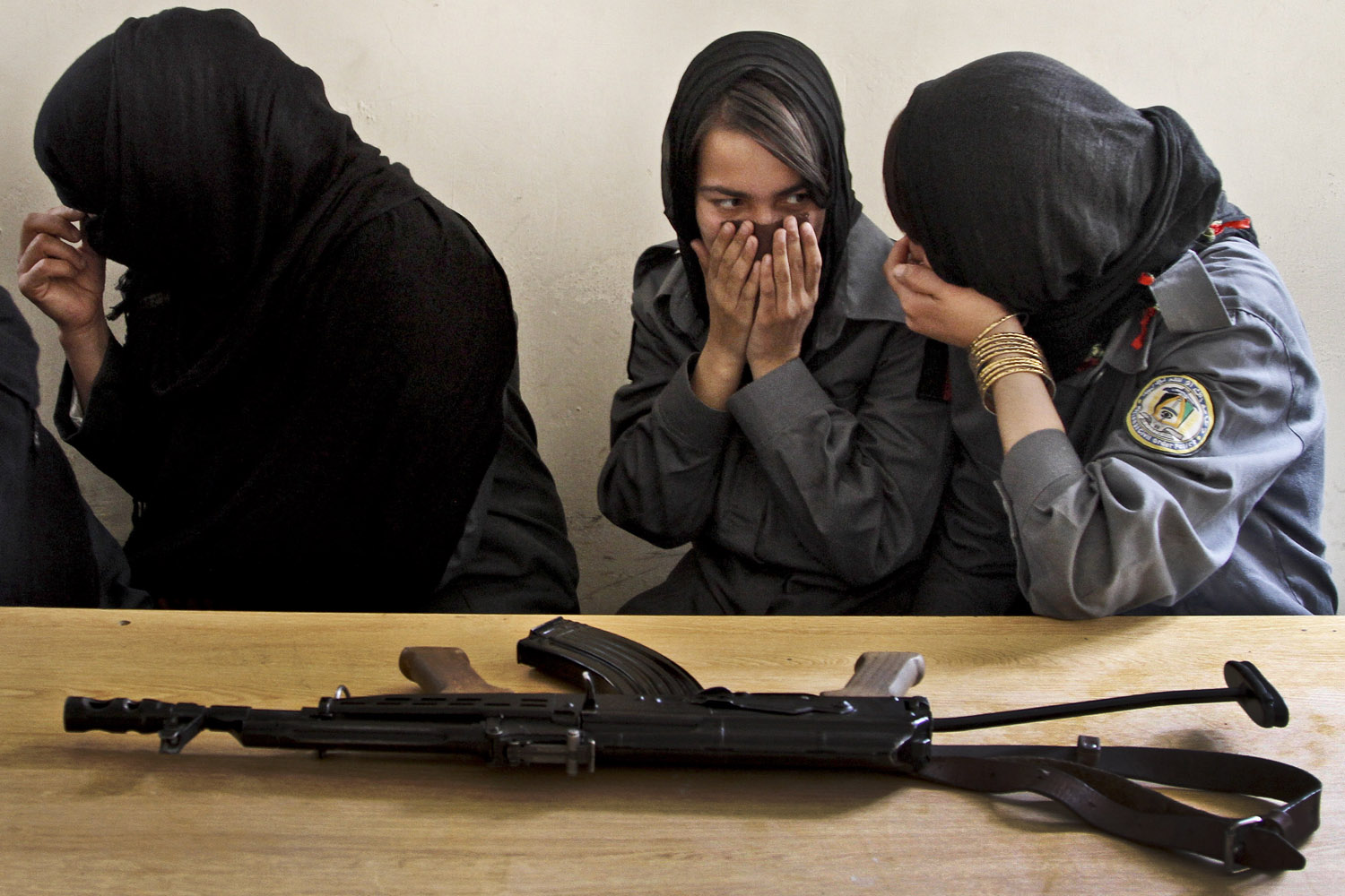 Sept. 25, 2013. Afghan female police officers share a joke during a training session at the Police Academy in Kabul.
