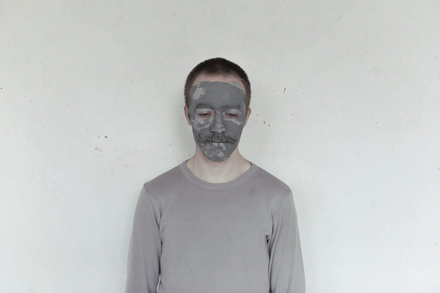 Portrait taken just after participant made his face imprint into the canvas. Iceland, 2011.