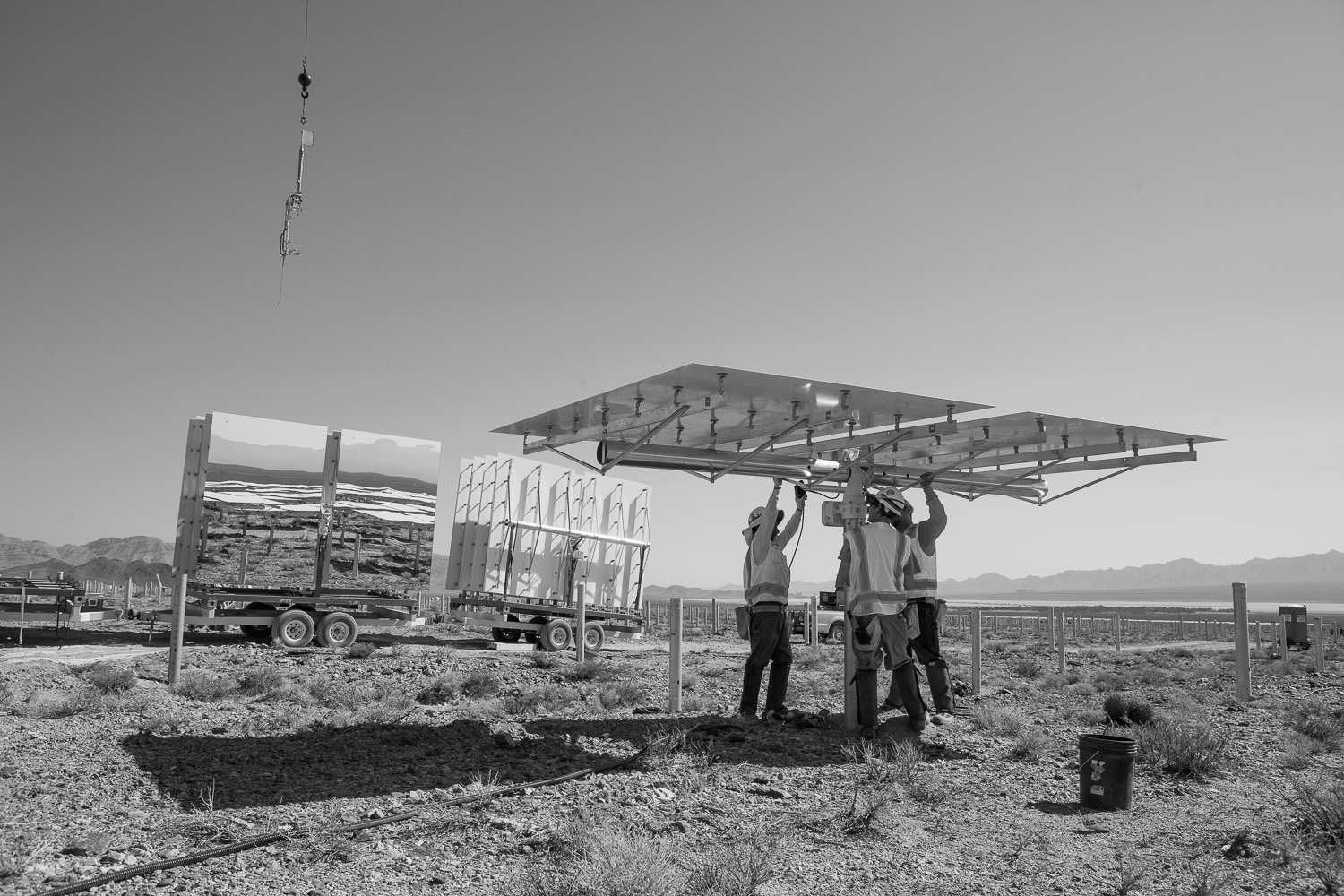 <i>Heliostat installation, June 2012</i>                                   Workers installing a heliostat at Solar Field One.