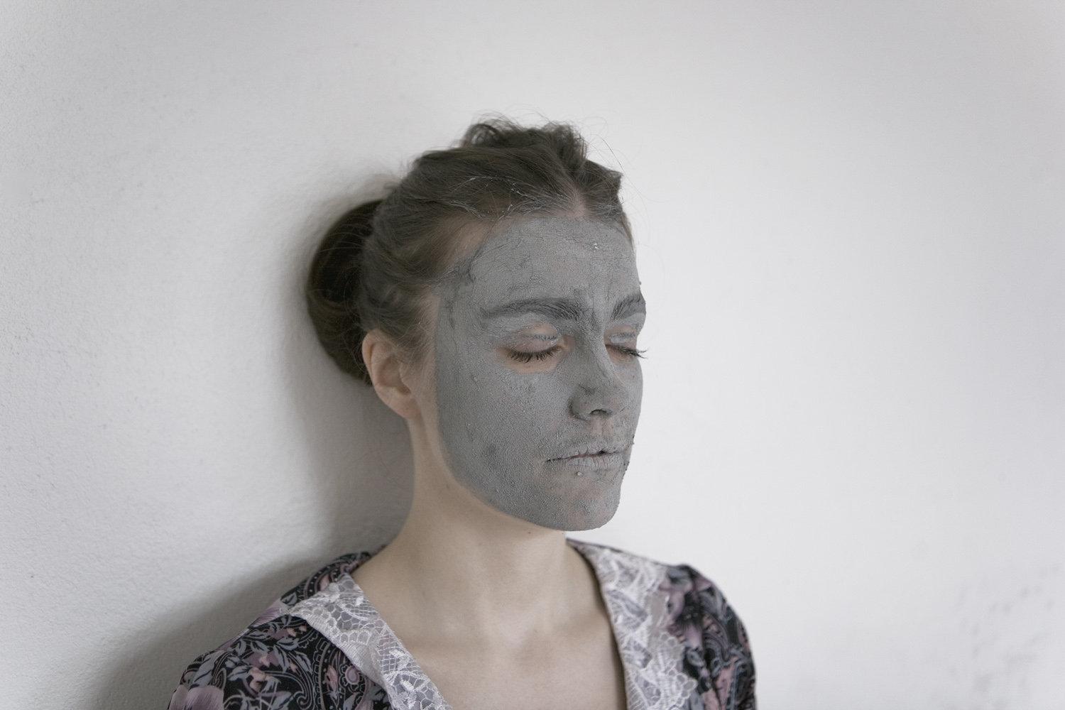 Portrait taken just after participant made her face imprint into the canvas. Iceland, 2011.