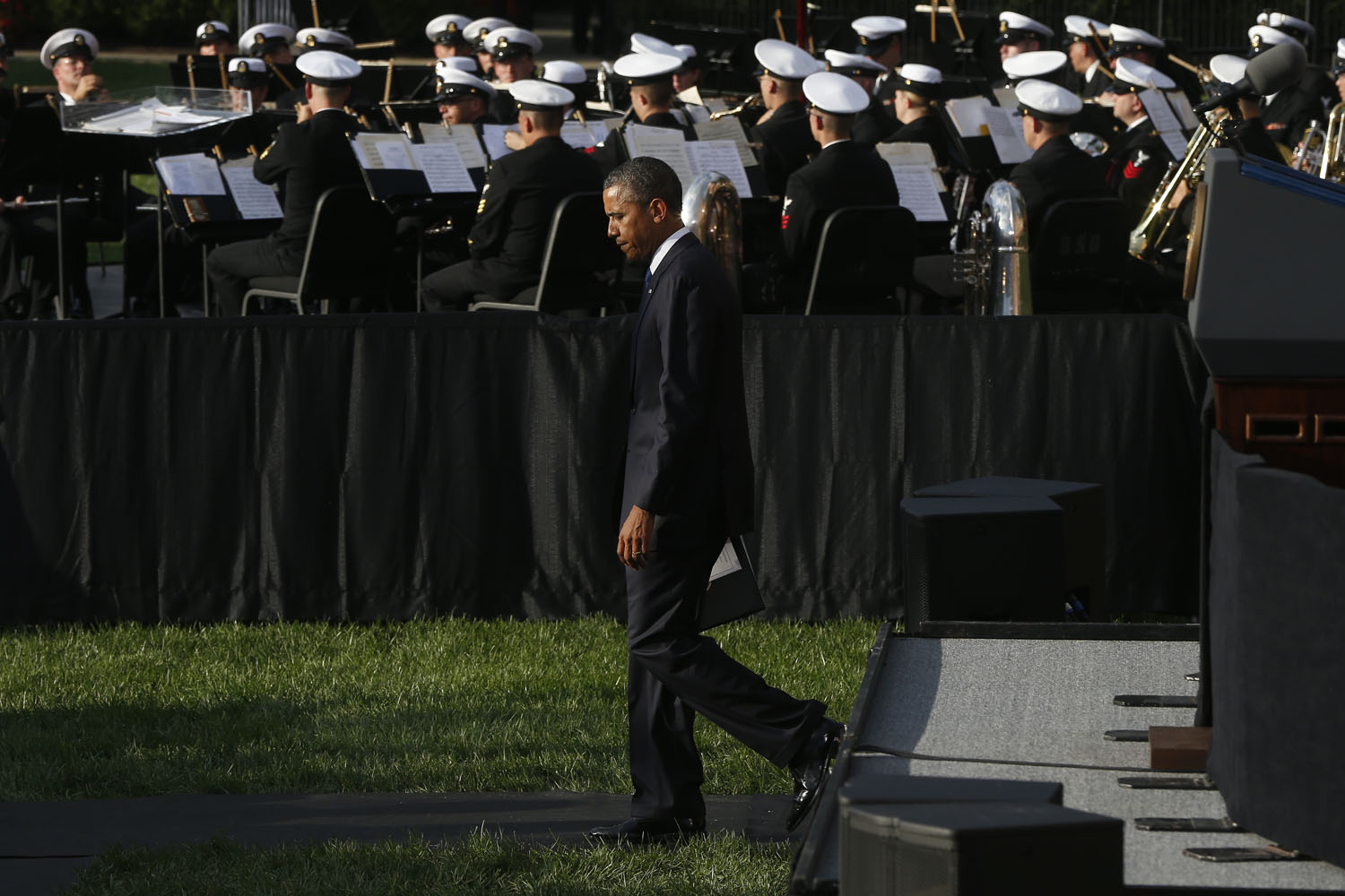 Sept. 22, 2013. President Barack Obama leaves the stage after he spoke at a memorial service for the victims of the Washington Navy Yard shooting at Marine Barracks in Washington.
