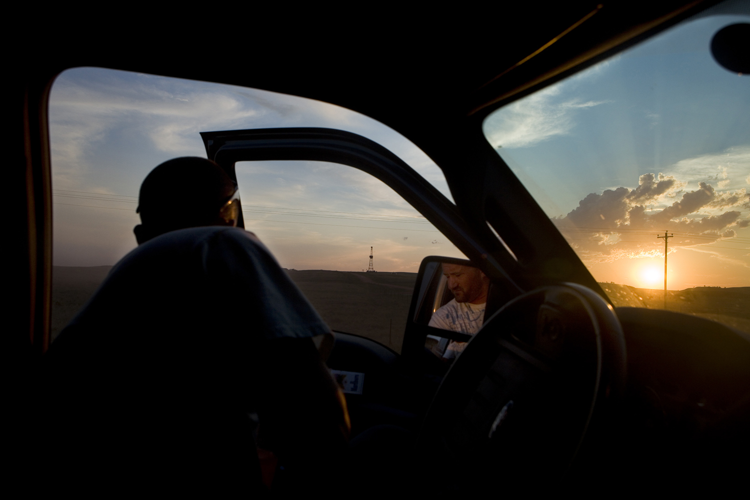 When creating Black Rush Life I saw how film making could be overwhelming for one person.  Once I had a team  to help shoot, produce, and edit, I could focus on directing and not worry about everything else.  Working with Reel Peak Films gave me the ability to direct a much better film. It is exciting to be part of a team that works collaboratively with many projects.  Print media has a growing need for quality film content for the web, but until this point I have not seen a production company that connects talent to clients and helps facilitate the process from beginning to end.   -Christina ClusiauPictured: Film still from  Black Rush Life,  2013. Brady Larkin, co-owner of Liquid Connection exits his truck on the way to a job site in Belfield, North Dakota, July 11, 2012. Larkin, after struggling to make a living wage in Grand Forks, North Dakota moved to Belfield and started his own trucking company. For many, this oil boom breathes opportunity and represents another shot at the American Dream.