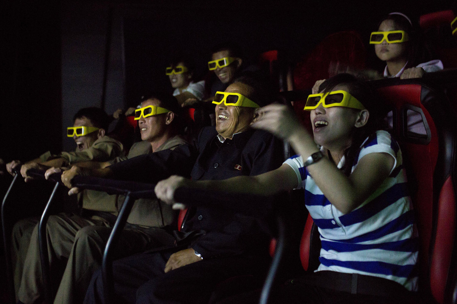 Sept. 22, 2013. North Koreans ride on an amusement park ride while watching a 3D movie at the Rungna People's Pleasure Park in Pyongyang.