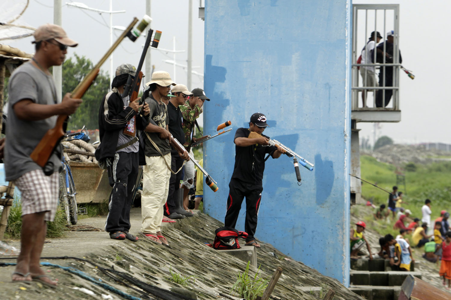 Sept. 24, 2013. Filipino riflemen shoot fish at a flood control facility in Taguig city, south of Manila, Philippines.
