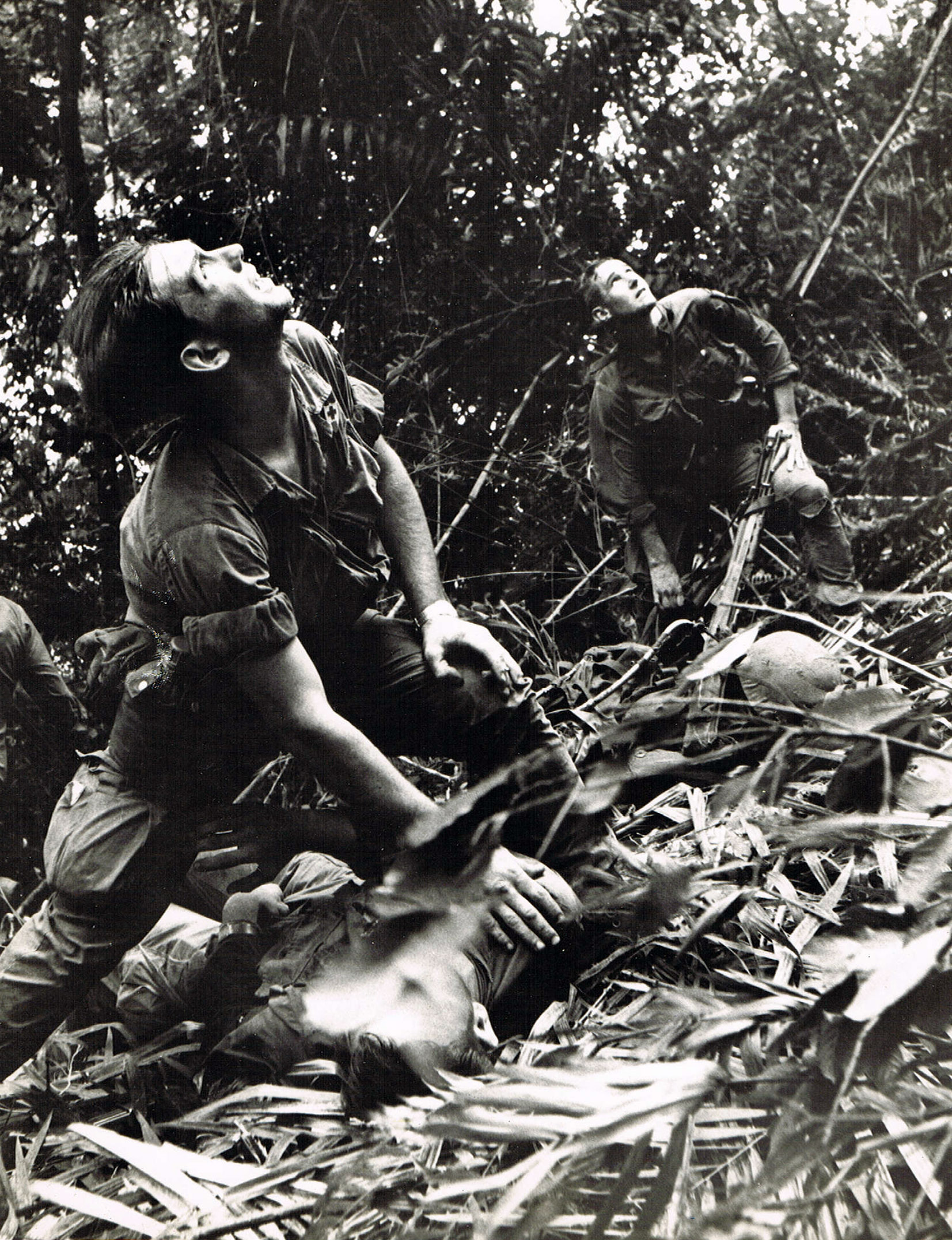 A paratrooper of A Company, 101st Airborne, guides a medical evacuation helicopter through the jungle foliage to pick up casualties during a five-day patrol of an area southwest of Hue, South Vietnam, April 1968.