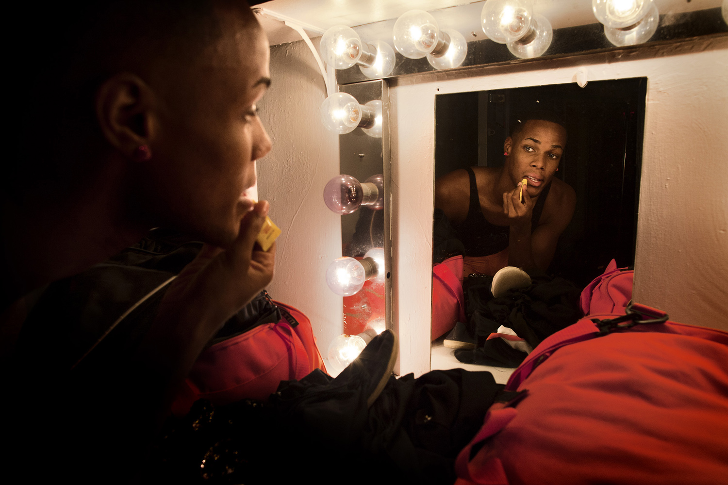 Adrian applies lip balm before practice. The team has been asked to perform at the Nappie Awards, an award show put on annually by Lagniappe, an independent bi-weekly newspaper in Mobile, Ala.