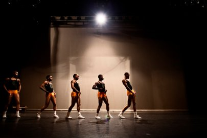 """The Prancing Elites rehearse before a performance at the Saenger Theater in Mobile, AL. The group was recruited to perform at the Nappie Awards, an award show put on annually by Lagniappe, an independent bi-weekly newspaper in Mobile, AL. Since a video of team dancing at an LGBT basketball game went viral after being tweeted by former NBA star Shaquille O'Neal, the team has gained semi-celebrity status around Mobile, has been flown out to Los Angeles to appear on a tv talk show, and is currenly looking to star in a reality show about their lives. The Prancing Elites are a group of young, gay, black men who practice J-Sette, a form of dance birthed at Historically Black Colleges that is characterized by sharp, cheerleading-style movements and hip-hop performed to an eight-count beat. Traditionally, men cannot join college dance teams, so young gay black men have been forming their own J-Sette """"lines,"""" organizing competitions, and creating their own outlets to practice this type of dance."""