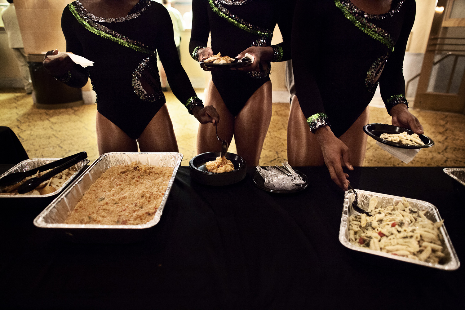 The Prancing Elites indulge in traditional Southern fare like shrimp and grits after a performance at the Saenger Theater in Mobile, Ala.