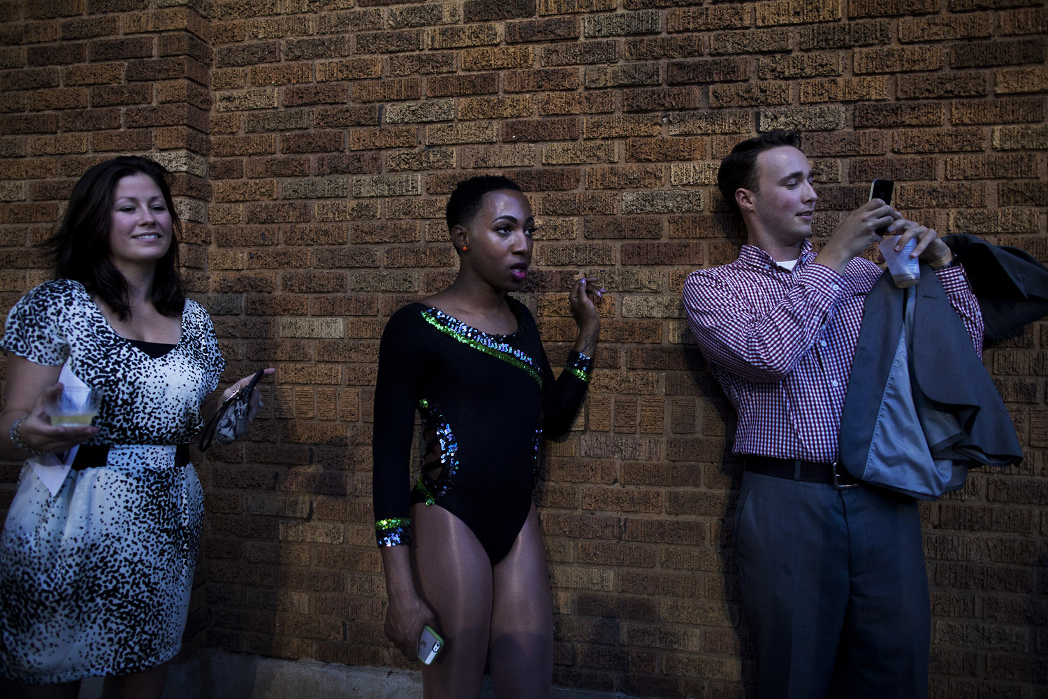 Jerel stands behind the Saenger Theater watching as fans of the Prancing Elites take photos with various the line members.