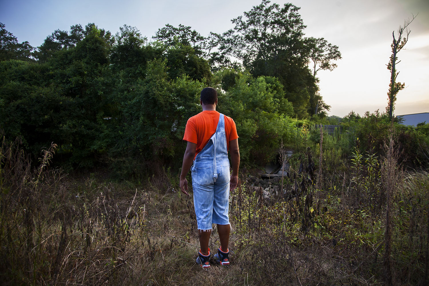 Kentrell surveys a dried creekbed a few blocks from his mother's home.