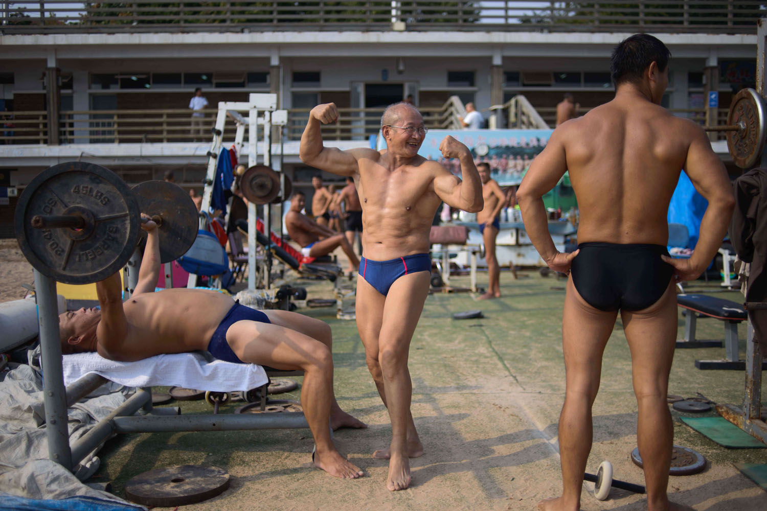 Sept. 21, 2013. A Chinese weightlifter flexes his muscles at an outdoor gym on a beach in Qingdao, Shandong province.