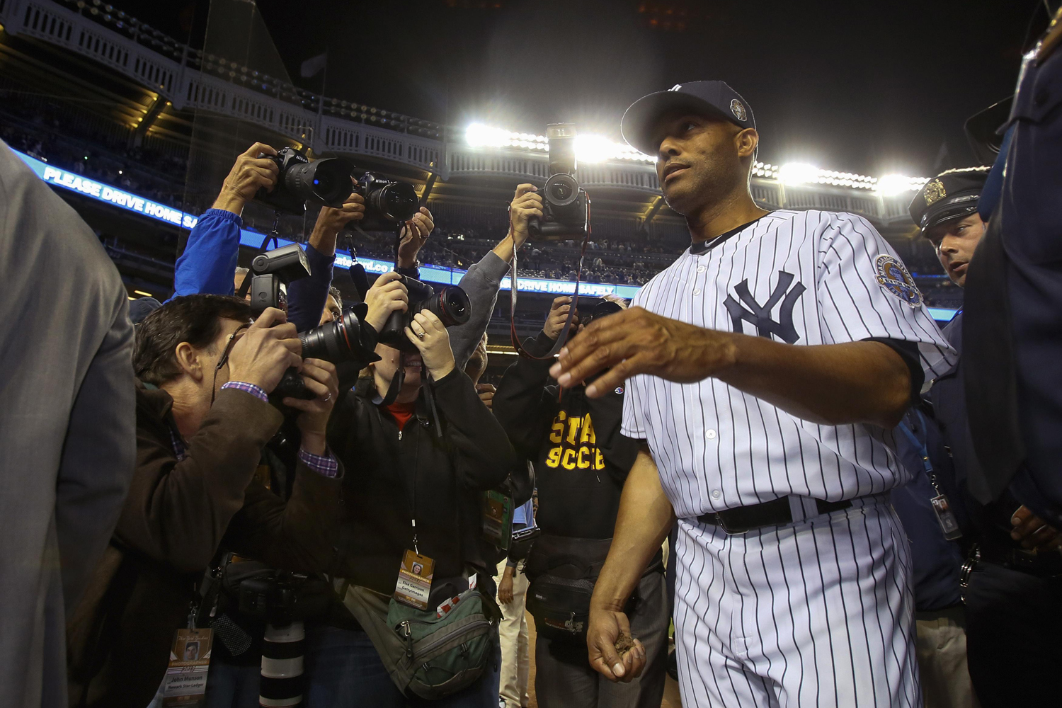 Sept. 26, 2013. New York Yankees relief pitcher Mariano Rivera clutches dirt from the mound as he leaves his home field for the final time after their loss to the Tampa Bay Rays during their MLB American League game at Yankee Stadium in New York. Rivera will retire after the end of the season.