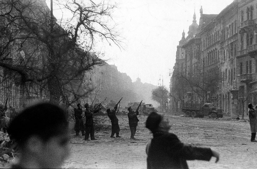 Rebels shoot vainly at an observation craft flying over Jozsef Circle. Soviet jet planes also . . . strafed the streets in support of the Soviet ground forces.