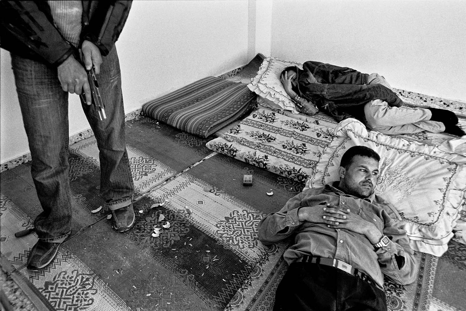 A siesta during an Israeli raid on the refugee camp of Rafah in the south of Gaza Strip, 2006.