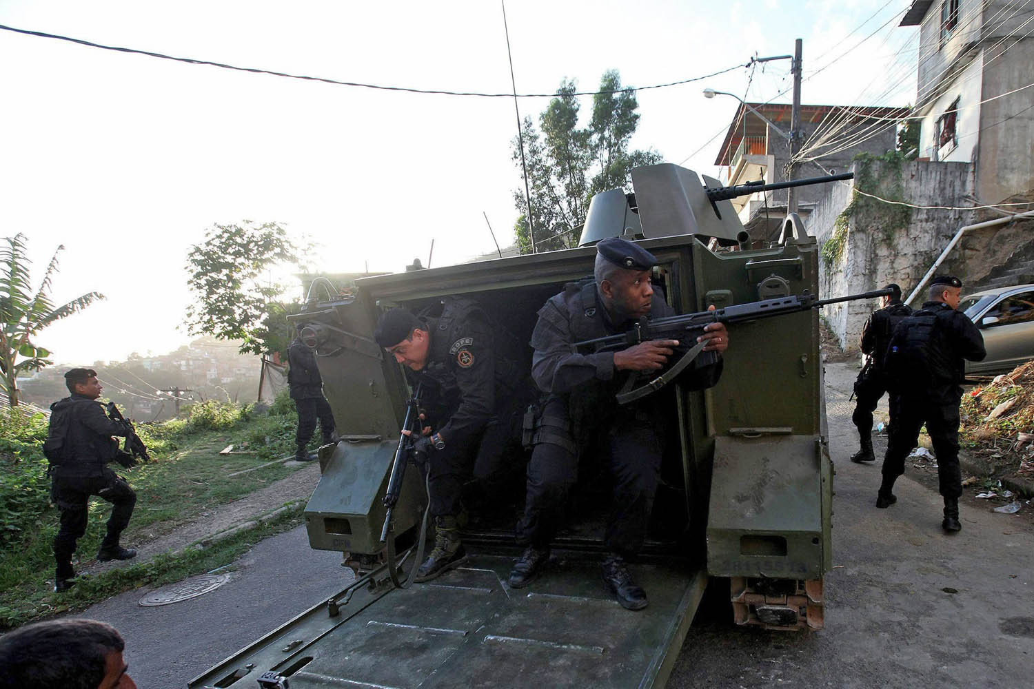 Oct. 6, 2013. Special forces of the Bazilian military police unboard an armored personnel carrier during an operation at the Lins de Vasconcelos favela in Rio de Janeiro.