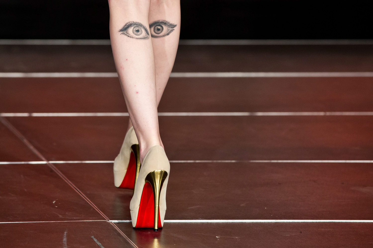 Oct. 7, 2013. A model with eyes tattooed on her calves takes to the catwalk during the 2013 fall/winter hairstyle trends ahead of the Bavarian championship and trade fair Hair, Beauty and more '2013 Hair' in Nuremberg, Germany.