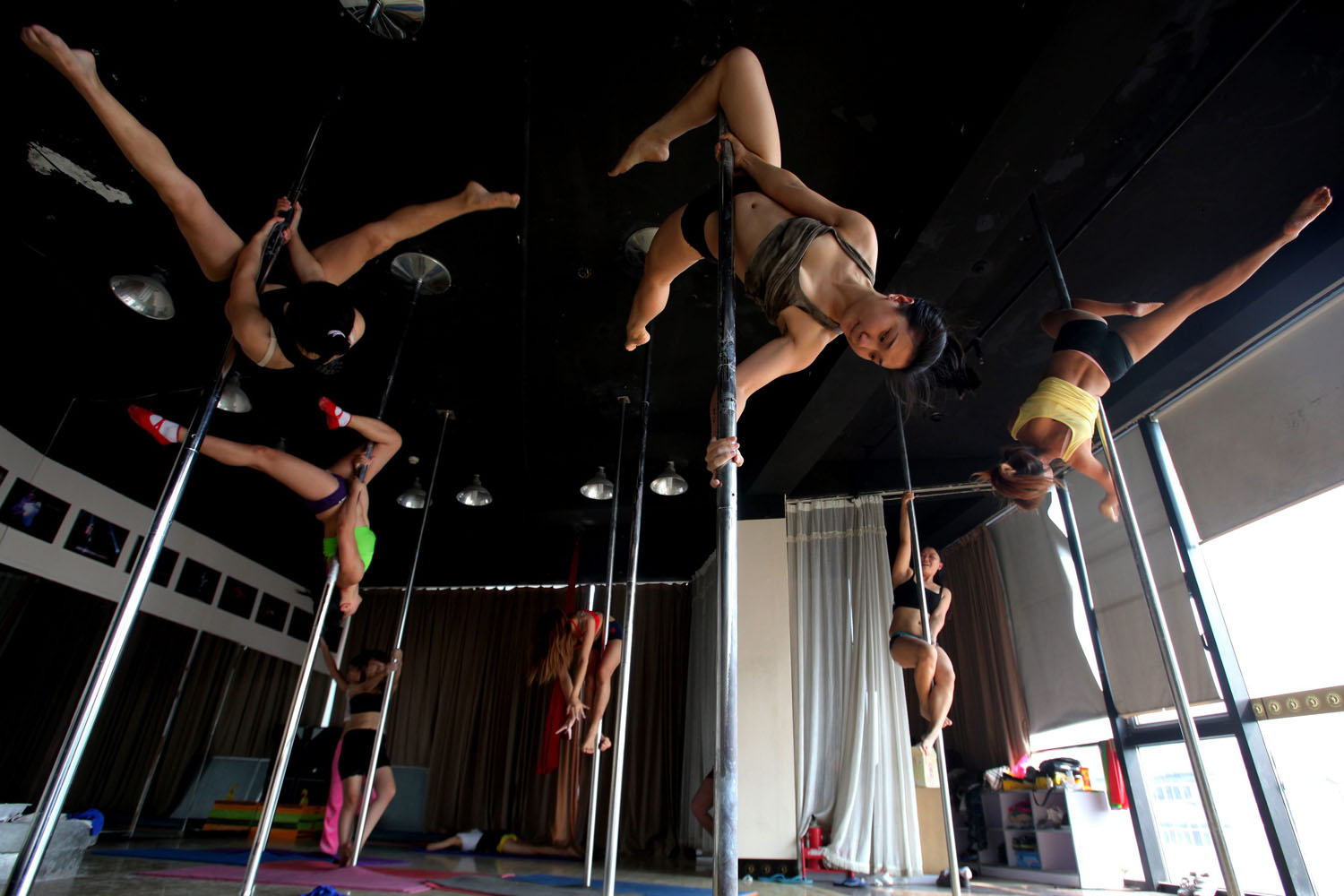 Oct. 8, 2013. Dancers perform during a training session at the pole dancing school in Tianjin city, China.
