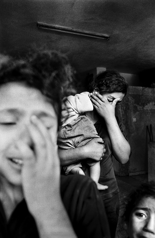 In Beit Hanoun, children cry for their mother, killed in at attack while she was preparing dinner, Gaza Strip, 2006.