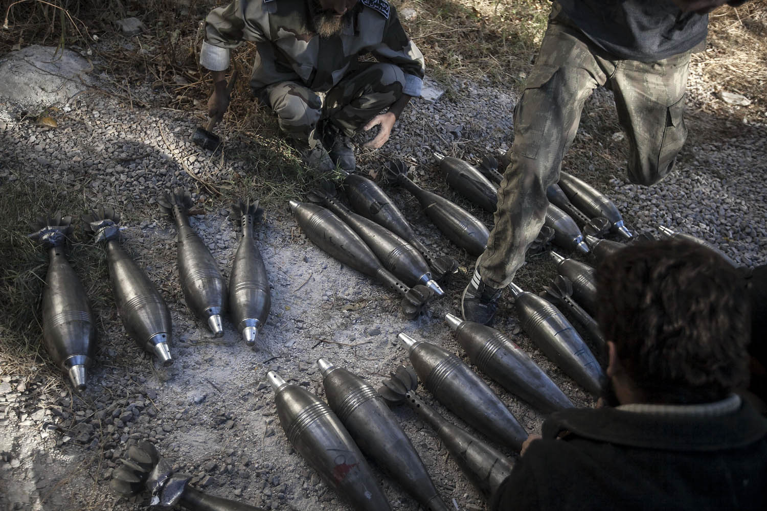 Oct. 07, 2013. Opposition fighters prepare loads of mortars during an attack in the Wadi al-Deef military post at the frontline in Maaret al-Numan in the Idlib province countryside of Syria.
