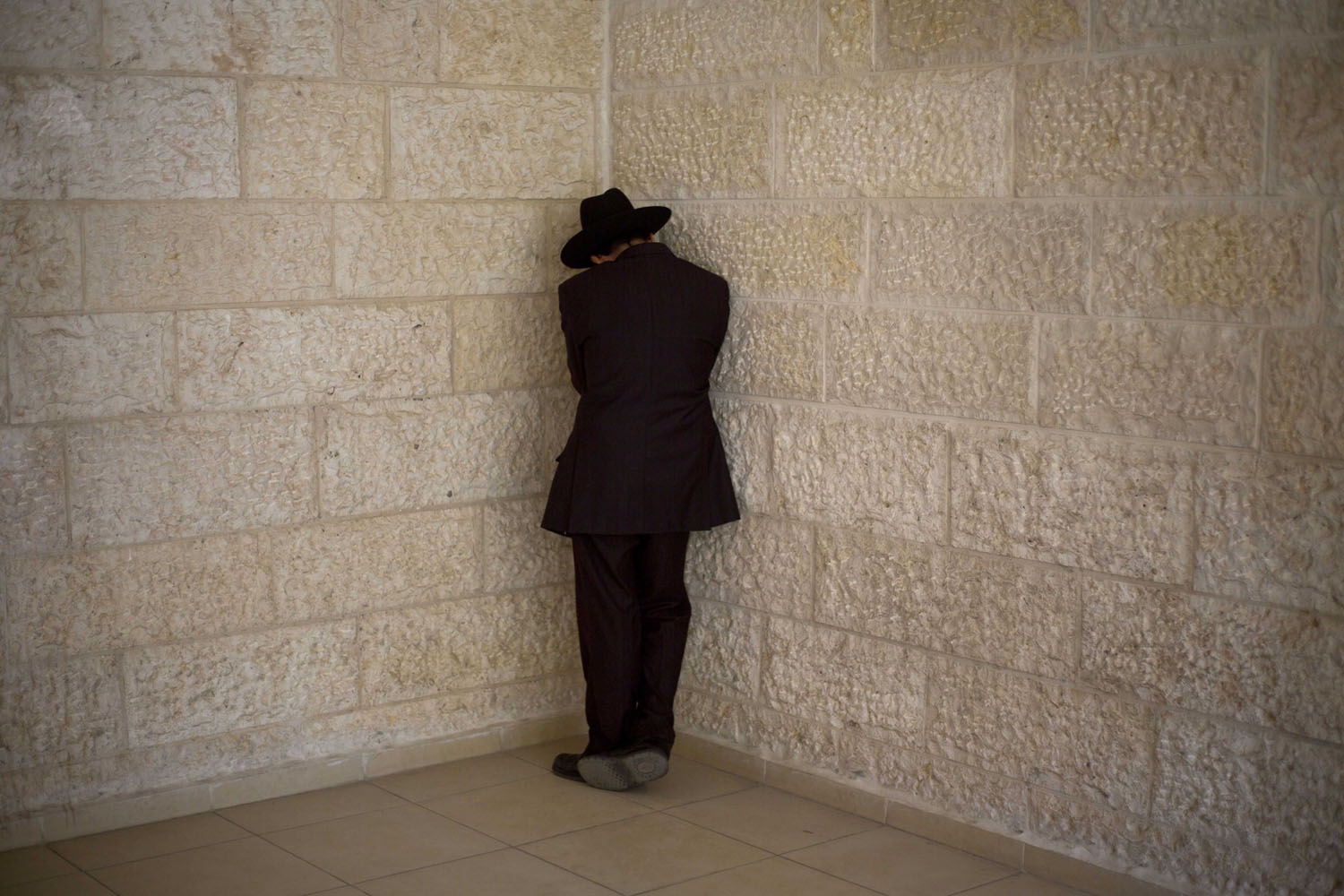 Oct. 7, 2013. An Orthodox Jew weeps after receiving the news about the death of Rabbi Ovadia Yosef outside of the rabbi's home in Jerusalem.