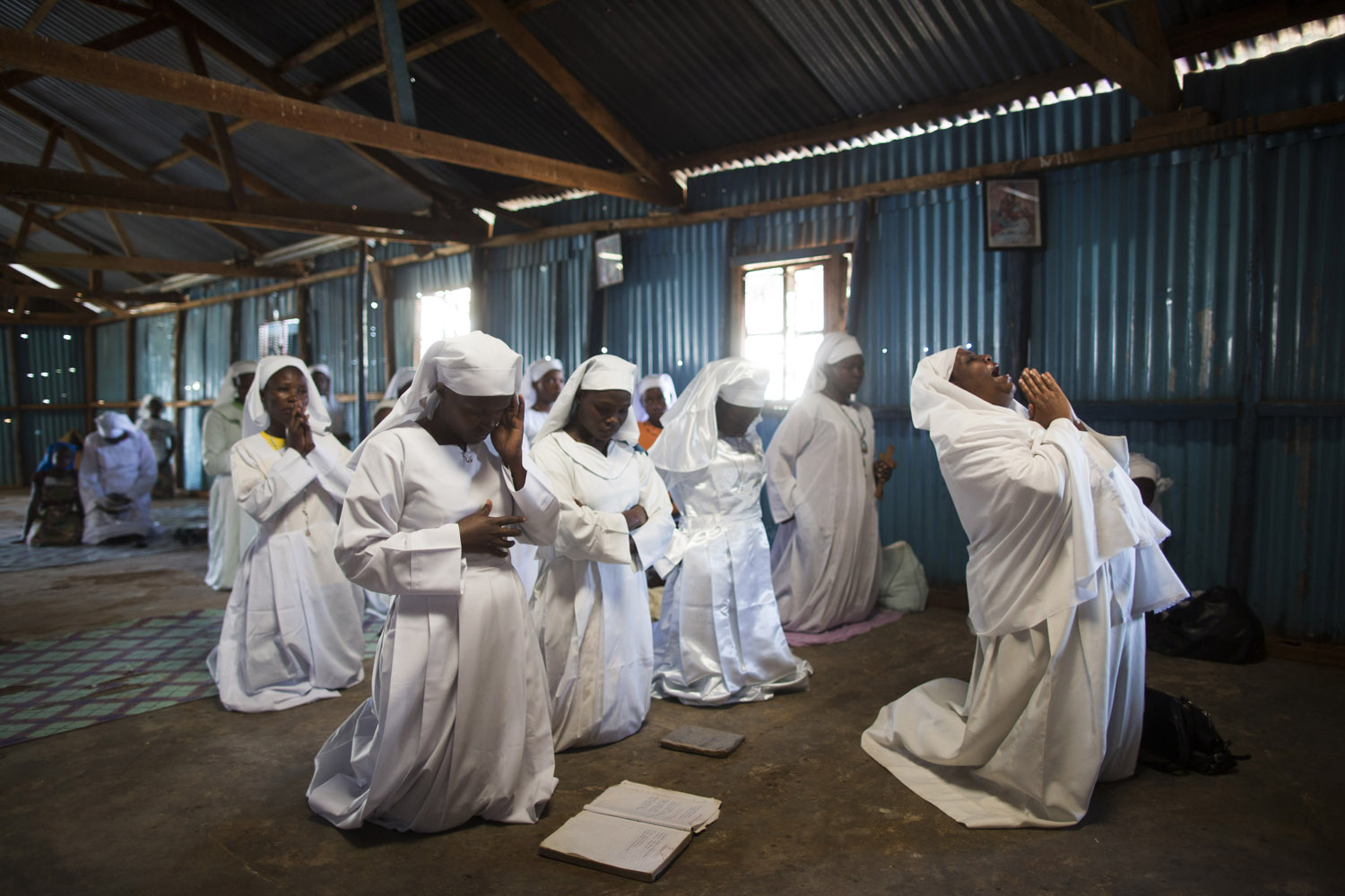 Sept, 29, 2013. Kenyans pray as they hold a church service for the victims of the Westgate Shopping Center attack in Nairobi, Kenya.