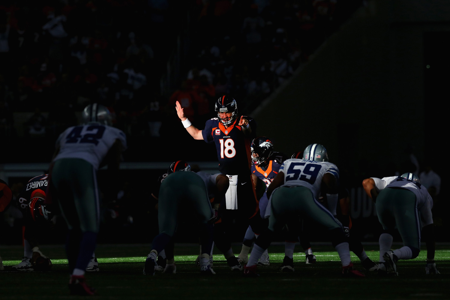 Oct. 6, 2013. Peyton Manning of the Denver Broncos calls a play against the Dallas Cowboys in the fourth quarter at AT&T Stadium in Arlington, Texas.