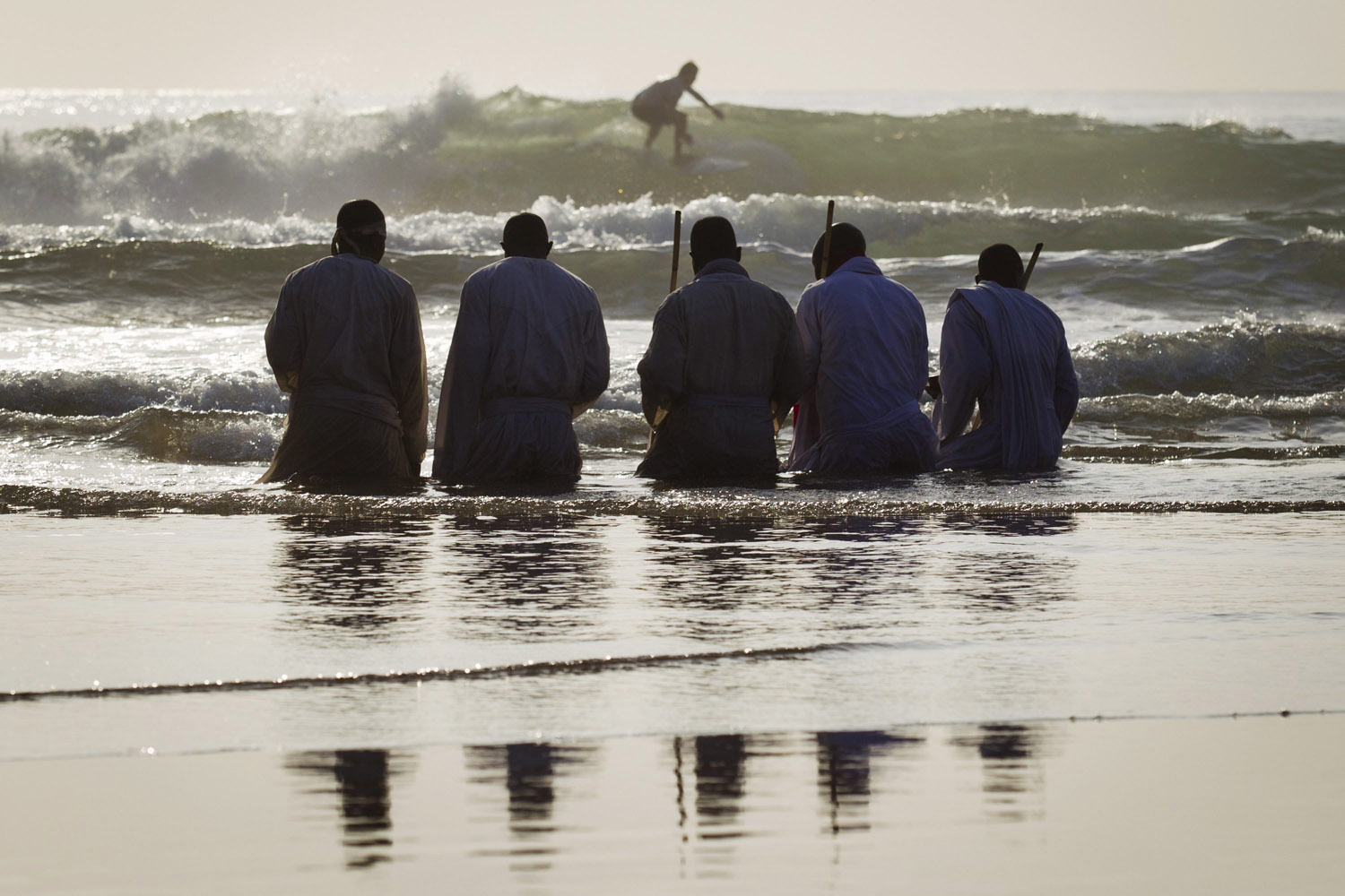 Oct. 5, 2013. Members of the Shembe Church pray while kneeling in water on the Durban beach front in South Africa.