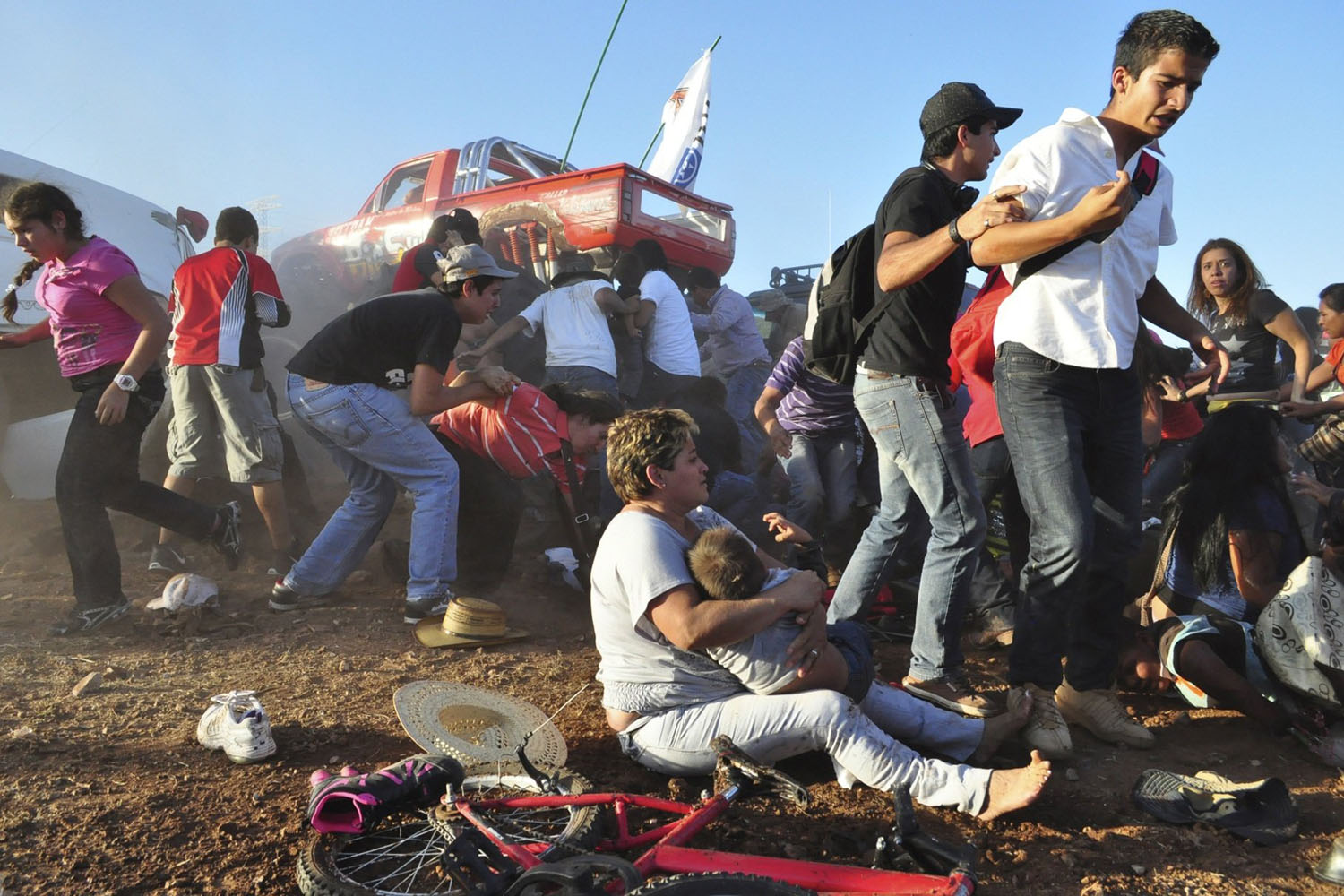 Oct. 5, 2013. Spectators react after a monster truck rammed the stand where they were watching a monster truck rally show at El Rejon park, on the outskirts of Chihuahua, Mexico.