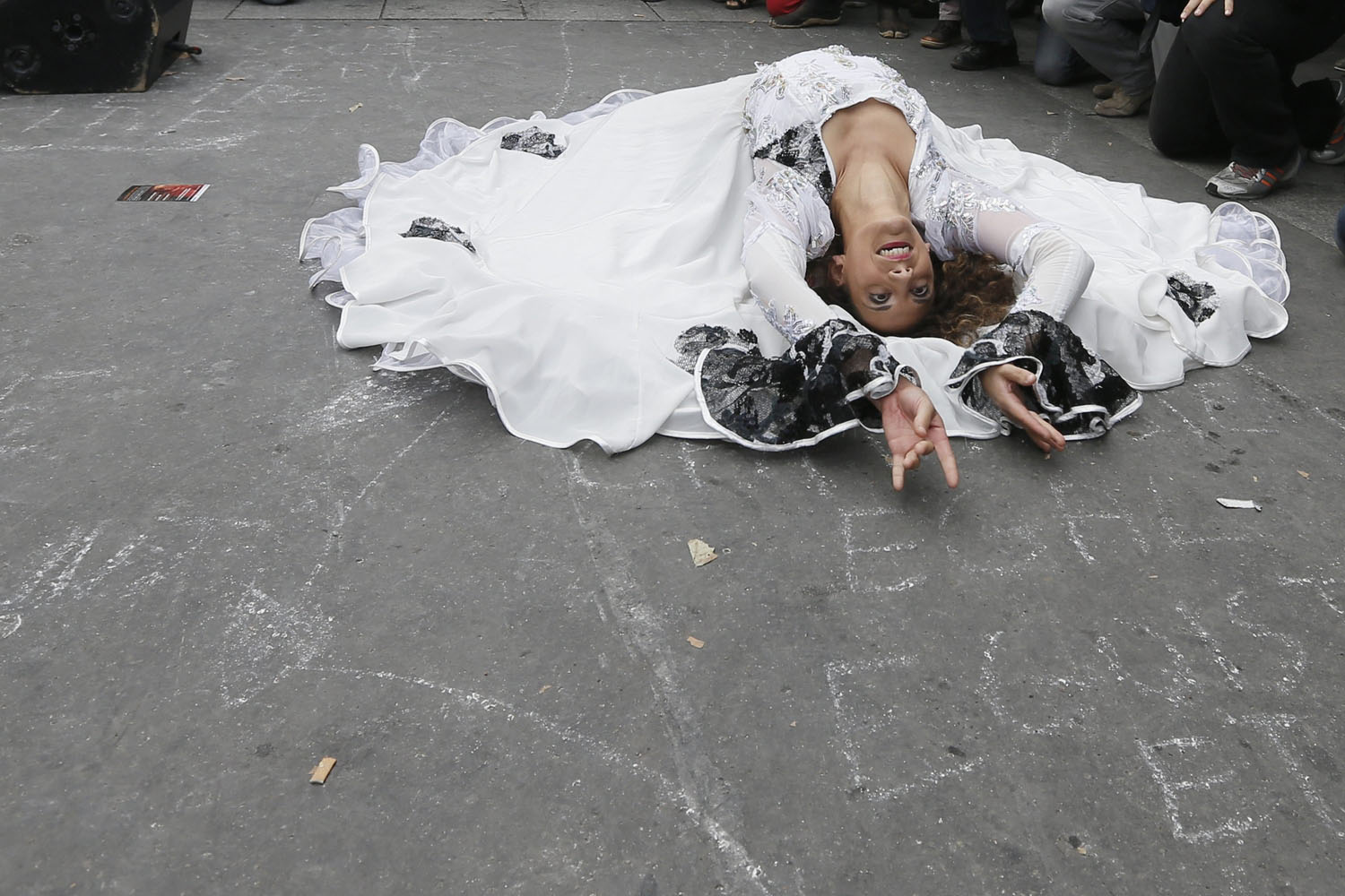 Oct. 6, 2013. A Roma woman dances as she attends a gathering called  Roma Pride against Racism, and For Equality  in Paris.