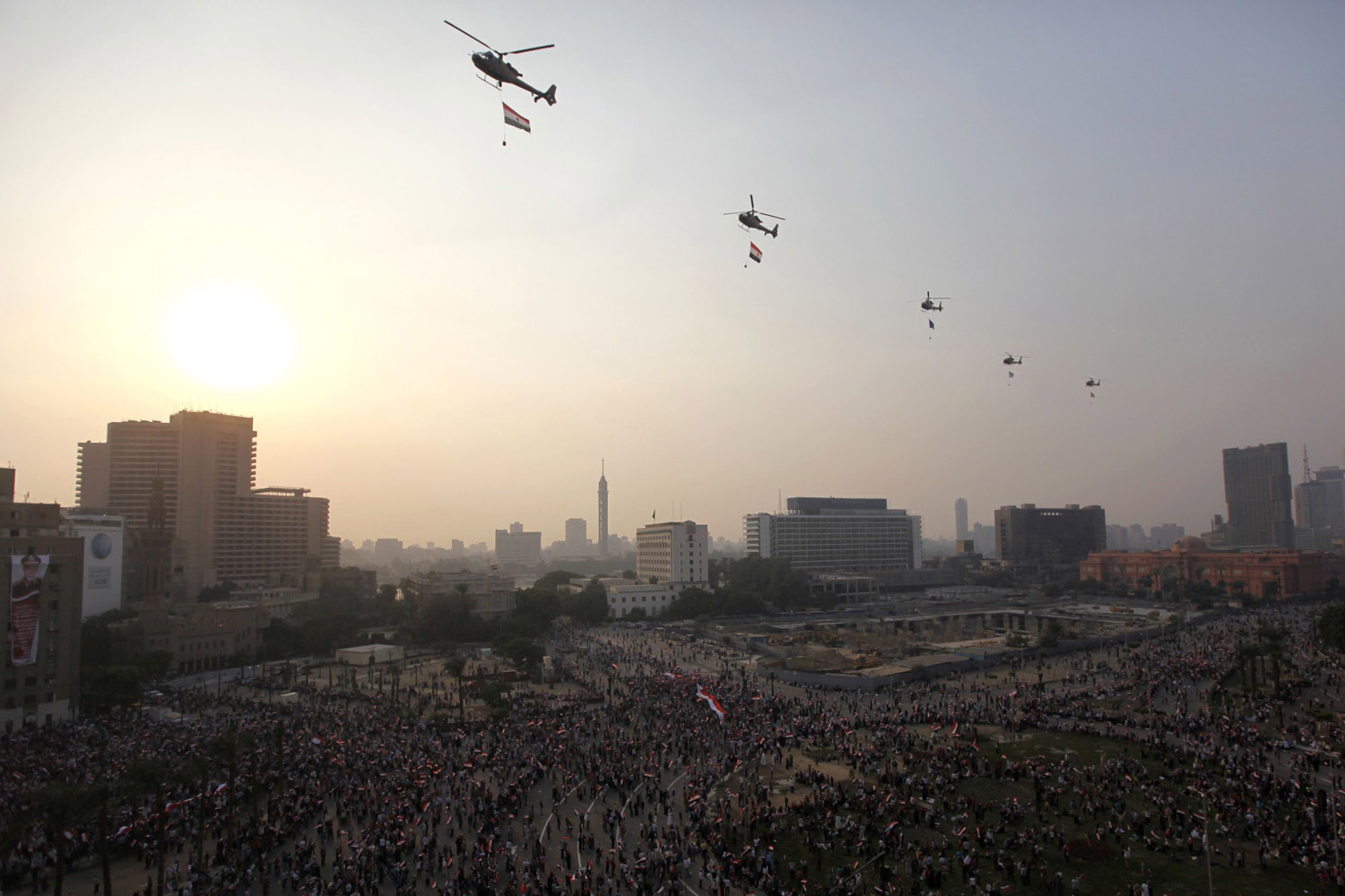 Oct. 6, 2013. Military helicopters are seen flying over Tahrir Square to celebrate the anniversary of an attack on Israeli forces during the 1973 war, in Cairo.